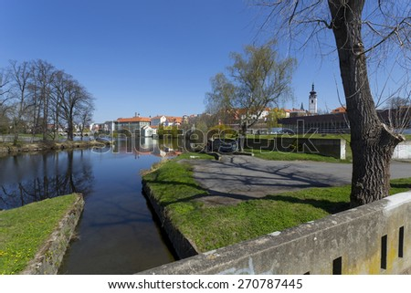 Colorful spring medieval Town Pisek above the river Otava, Czech Republic  - stock photo