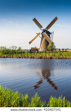 Colorful spring scene in the famous Kinderdijk canals with windmills, UNESCO world heritage site. Sunset in Dutch village Kinderdijk, Netherlands, Europe - stock photo