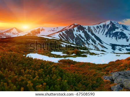 Colorful spring sunset in the mountains - stock photo