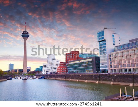 Colorful spring sunset of Rhein river at night in Dusseldorf. Rheinturm tower and a bridge in the soft evening light, Nordrhein-Westfalen, Germany, Europe. - stock photo
