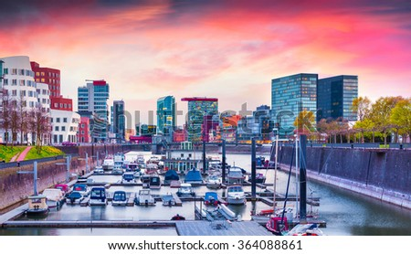 Colorful spring sunset on Rhine in Dusseldorf. Medienhafen in the soft evening light, Nordrhein-Westfalen, Germany, Europe. - stock photo