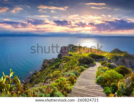Colorful spring sunset on the cape Milazzo, nature reserve Piscina di Venere, Sicily, Italy, Tyrrhenian sea, Europe. - stock photo