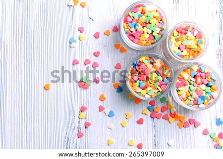 Colorful sprinkles in bowls on table close-up - stock photo