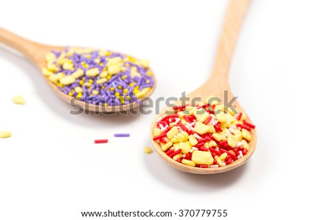 Colorful sprinkles, topping icecream and cake in spoon.