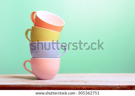 Colorful stack coffee cups on wood board - stock photo