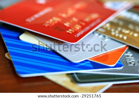 Colorful stack of credit cards and shopping gift cards.  Macro with extremely shallow dof. - stock photo