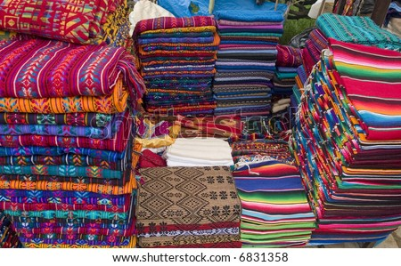 Colorful stack of Mexican shirts - stock photo