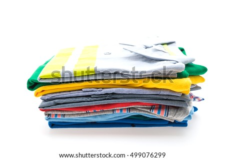Colorful Stack of T Shirt and Polo isolated on white background
