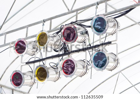 colorful Stage lights on steel frame - stock photo