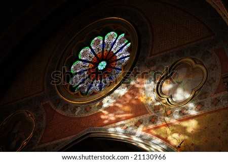 colorful stained-glass window in catholic cathedral - stock photo
