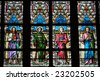 colorful stained-glass window in St.Vitus cathedral in Czech capital Prague - stock photo