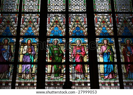 colorful stained-glass window in St.Vitus cathedral in Czech capital Prague