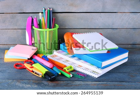 Colorful stationery on wooden background - stock photo