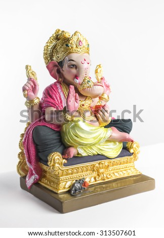 Colorful statue of Ganesha idol. Side view on white background. - stock photo