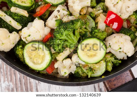 Colorful steamed vegetable on pan, top view. Culinary vegetarian and vegan healthy eating. - stock photo