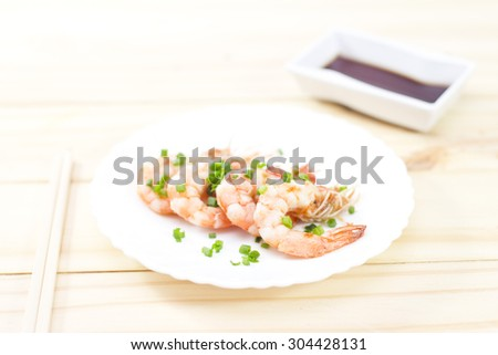Colorful Steaming Shrimpon wooden background. - stock photo