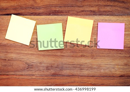 Colorful sticker paper note attach on wood wall with blank space, business concept of making note. - stock photo