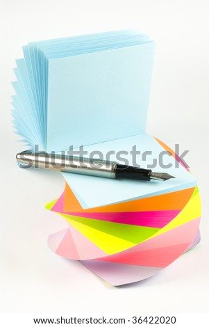 Colorful sticky notes with ink pen isolated on white background