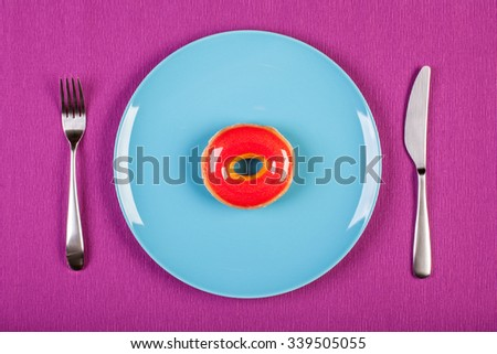 colorful stock image of doughnut on a plate. diet concept - stock photo
