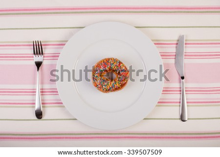 colorful stock image of doughnut on white plate. diet concept - stock photo