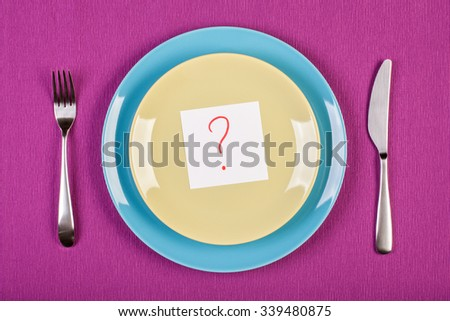 colorful stock image of note with question mark on two plates. diet concept - stock photo