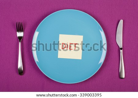 colorful stock image of sticky note with diet text lying on a plate. diet concept - stock photo