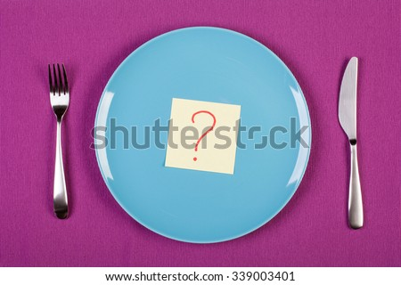 colorful stock image of sticky note with question mark lying on a plate. diet concept - stock photo
