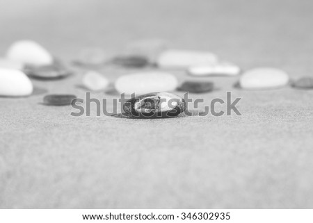 Colorful stones on the ground. This image shows tells that everyone is unique on it's different way but still important. Image has a vintage effect applied. - stock photo