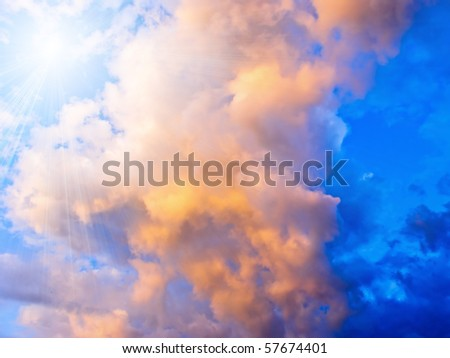 Colorful stormy clouds and sun - stock photo