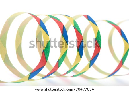 Colorful streamers in front of white background