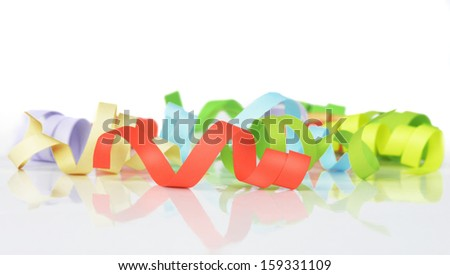 colorful streamers on a white background - stock photo
