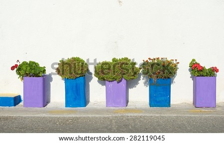 Colorful street fragment close up, colorful vases close up, exterior detail, greece exterior, colourful background, street decoration. Exterior. House decor. Exterior decor - stock photo