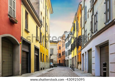 Colorful street with many cozy houses in Parma, Emilia-Romagna region, Italy. - stock photo