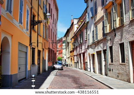 Colorful street with many old houses in Parma city, Emilia-Romagna region, Italy. Ancient alley in Italian town. - stock photo