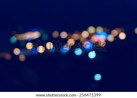 Colorful streetlights. Blurred spot of light outdoors - stock photo