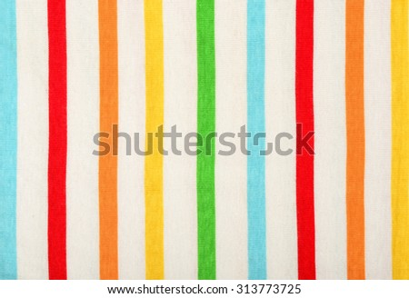 Colorful striped background. Vertical stripes pattern on white fabric.
