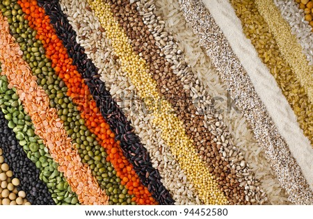 colorful  striped rows of dry lentils, soya beans, groats ,peas, grain ,buckwheat, soybeans, legumes, rice, backdrop texture - stock photo