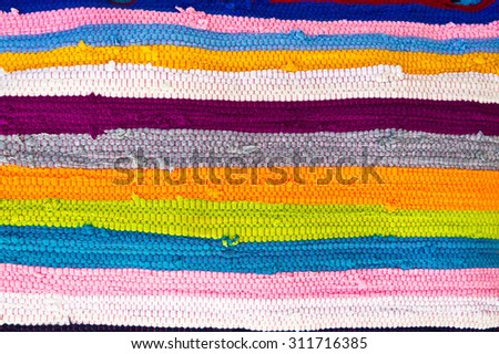 Colorful striped textile as a background image - stock photo