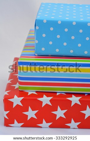 colorful stripes, dots, stars,flower pattern christmas, birthday and holidays presents gifts on a white  background - stock photo