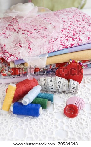 Colorful stuff for sewing at home, close up, vertical - stock photo