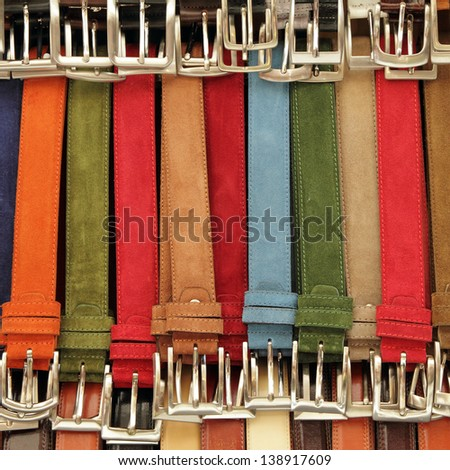 colorful suede trouser belts display - stock photo
