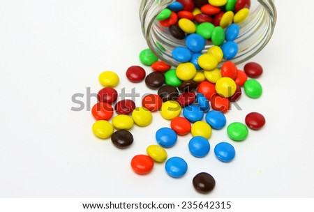 Colorful sugar-coated chocolate smarties on a white background - stock photo