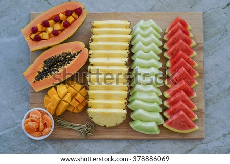Colorful summer, exotic fruit platter with watermelon, cantaloupe, papaya, mango and tangerines. Healthy Dessert Concept.  - stock photo