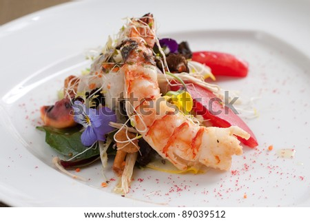 Colorful summer jumbo prawn salad with edible flowers