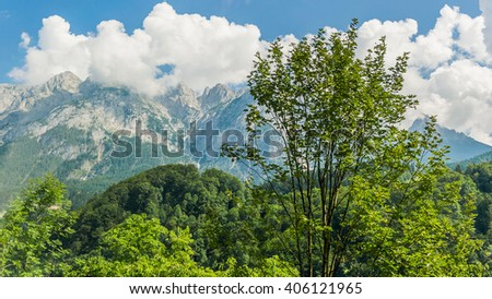 Colorful summer landscape of big clouds over the rocky wild mountains of the austrian Alps, near Salzburg, Austria - stock photo