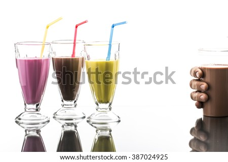 colorful summer milkshake with take away cup on bright background - stock photo
