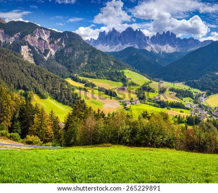 Colorful summer morning in the St. Magdalena or Santa Maddalena in the National Park Puez Odle or Geisler summits. Dolomites, South Tyrol. Location Bolzano, Italy, Europe. - stock photo