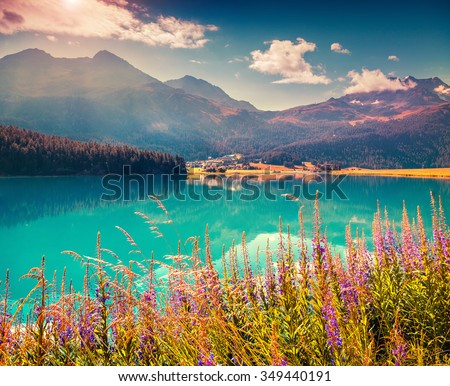 Colorful summer morning on the Champferersee lake. Silvaplana village in the morning mist. Alps, Switzerland, Europe. Instagram toning. - stock photo