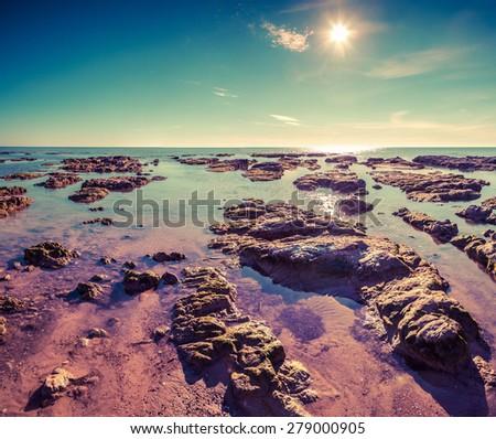 Colorful summer morning on the Giallonardo beach, Sicily, Italy, Medityrrhenian sea, Europe. Lomography stylization and instagram toning effect. - stock photo