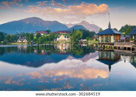 Colorful summer morning on the Grundlsee. Archkogl village in the morning mist. Alps, Austria, Europe.